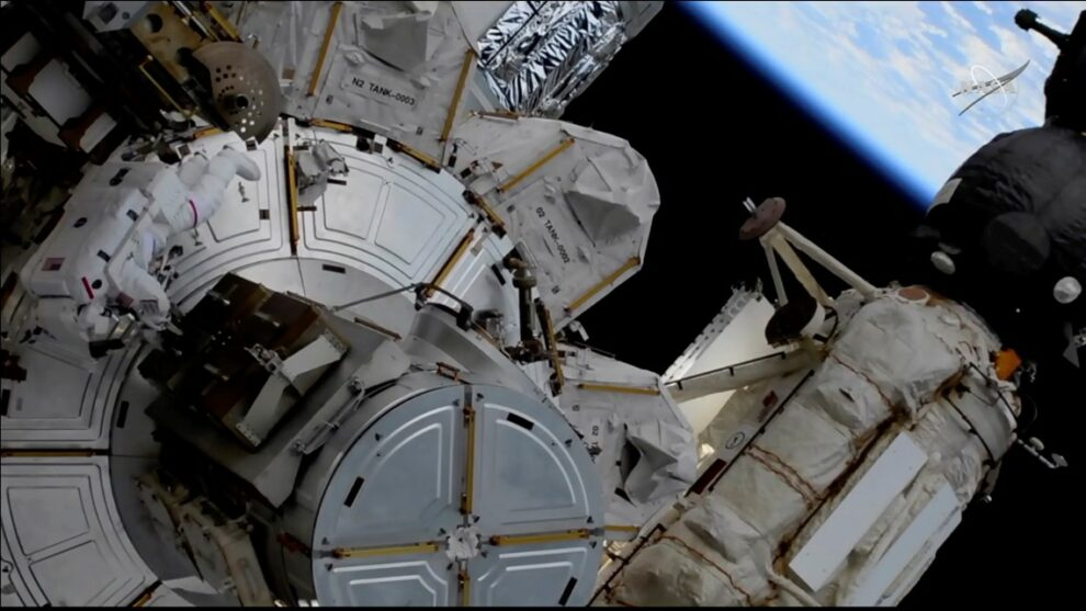 Astronauts conduct spacewalk outside International Space Station