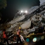Search for survivors of Miami-area building collapse goes into the night